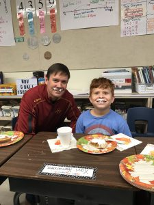 Principal and student eating pie